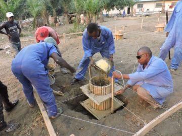 workers building solar